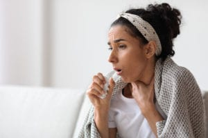 adult woman sick and coughing at home