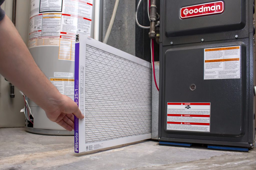 changing air filter on Goodman high-efficiency furnace in home
